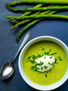 bowl of asparagus soup with chives