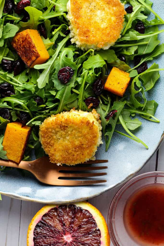 Fried Goat Cheese, greens, and orange dressing