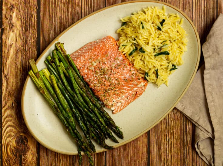 plate of salmon with orzo and asparagus