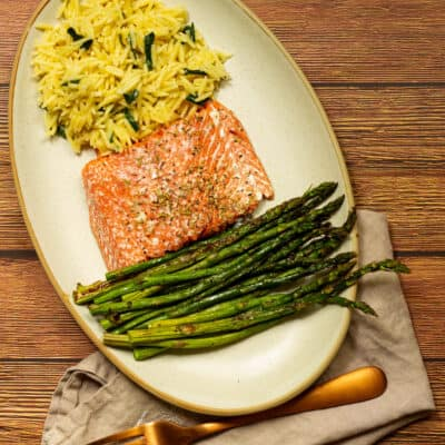 salmon, asparagus, and orzo with fork