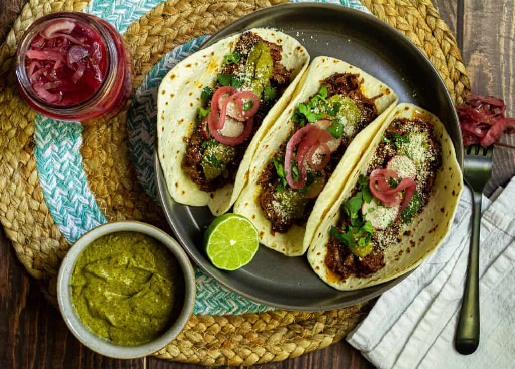 tacos with pickled red onion and poblano crema