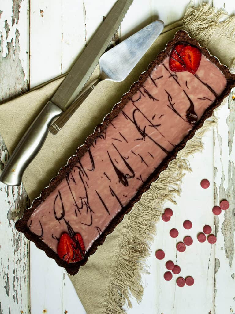 photo of whole ruby chocolate tart before it is sliced