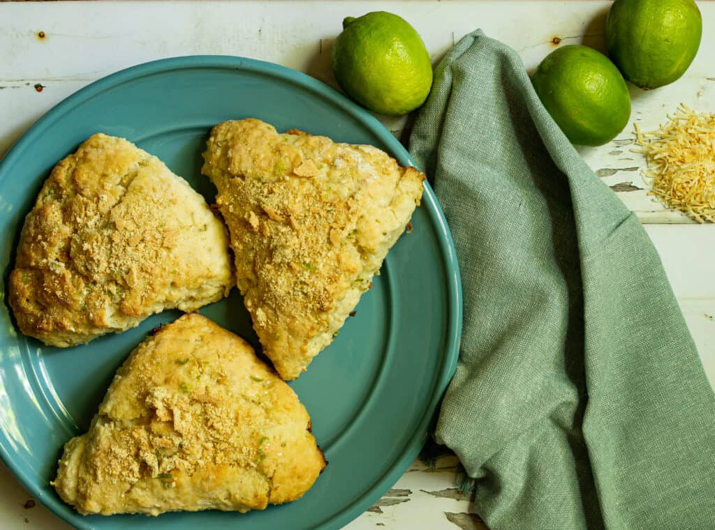 scones on a blue plate with a green napkin