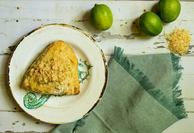 scone with a napkin and limes